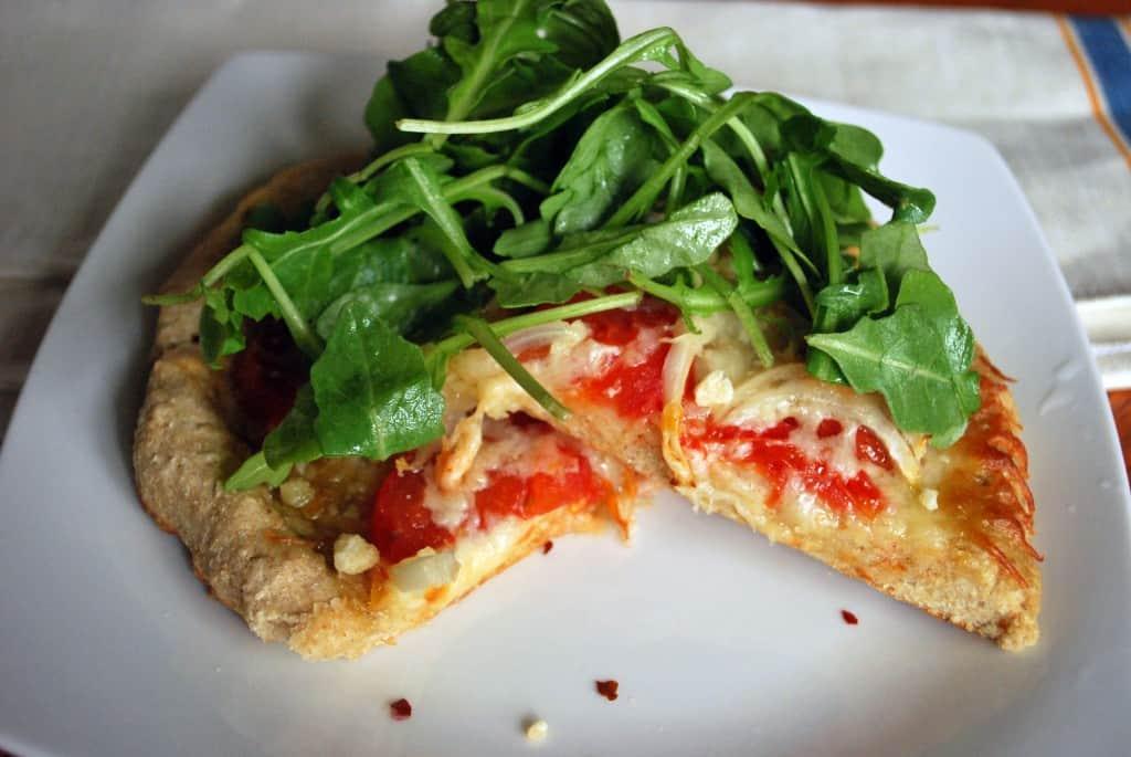 Tomato Onion and Arugala Pizza