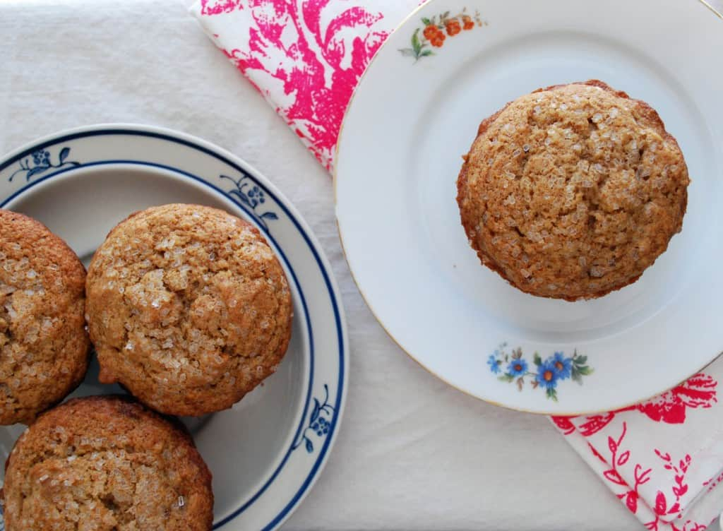 apple spice muffins on flowered plates with a bright napkin