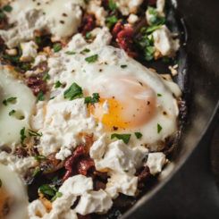 mediterranean eggs in a cast iron skillet