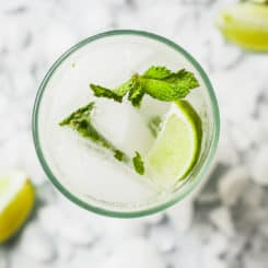 Mojitos by the Pitcher - The perfect signature cocktail for parties! #easy #cocktails #mojito #pitcher #lime #rum #mint
