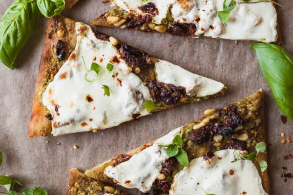 Pesto Flatbread Pizza - An easy weeknight dinner recipe that is vegetarian and full of flavor. #weeknightmeal #dinner #pizza #flatbread #vegetarian #meatless