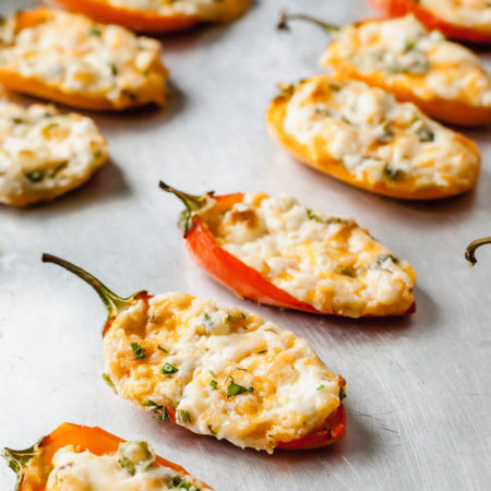 zesty cream cheese stuffed mini peppers on a baking sheet