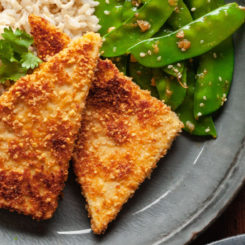 pan fried peanut tofu on a blue plate