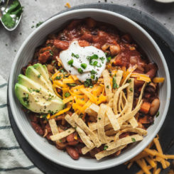 a bowl of easy vegetarian chili in a blue bowl