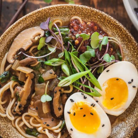 close up photo of vegetarian ramen with dragon eggs in a bowl